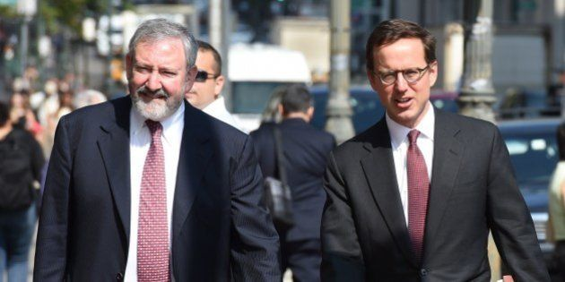 Attornies Carmine Boccuzzi (R) and Jonathan Blackman arrive at the US Federal Courthouse July 22, 2014...