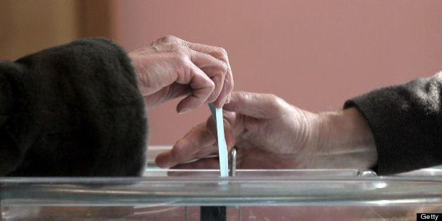A person casts his ballot during a referendum for joining local authorities, on April 07, 2013 in Strasbourg,...