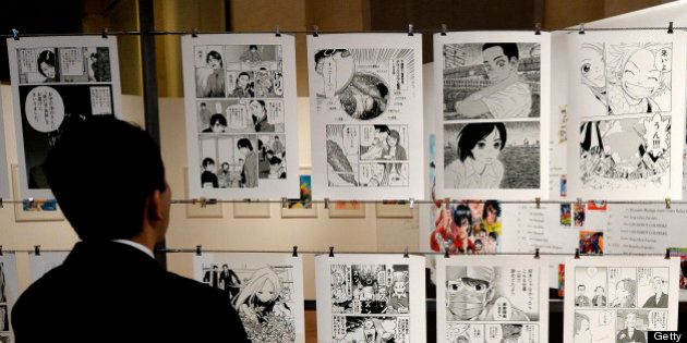 A visitors walks in the time tunnel exhibit of the 'Milano Manga Festival' on May 2, 2013 during the...