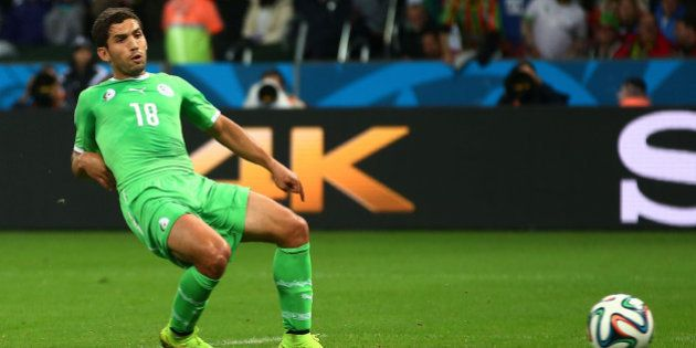 PORTO ALEGRE, BRAZIL - JUNE 30: Abdelmoumene Djabou of Algeria scores his team's first goal in extra...