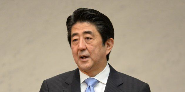 Japanese Prime Minister Shinzo Abe delivers a speech during the Japan Business Federation general assembly...