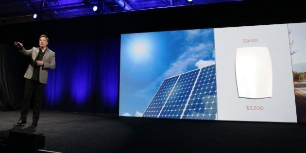 Tesla Motors CEO Elon Musk unveils large utility scale home batteries at the Tesla Design Studio in Hawthorne,...