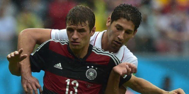 US defender Omar Gonzalez (R) and Germany's forward Thomas Mueller vie for the ball during a Group G...