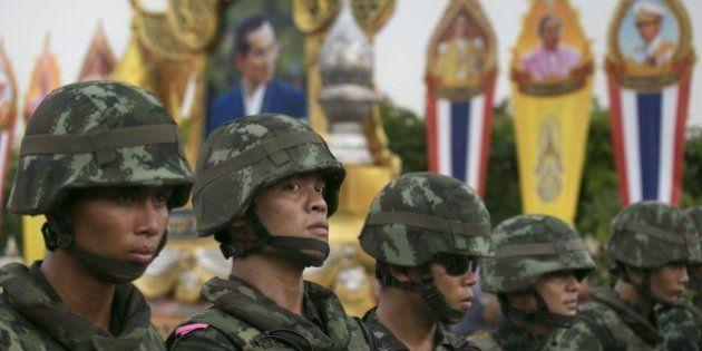 BANGKOK, THAILAND - MAY 26: Thai military stand guard near portraits honoring Thai King Bhumibol Adulyadej...