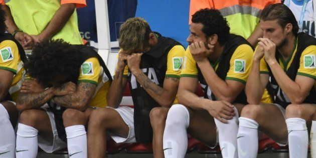 (L-R) Brazil's defender Marcelo, Brazil's injured forward Neymar, Brazil's forward Fred and Brazil's...