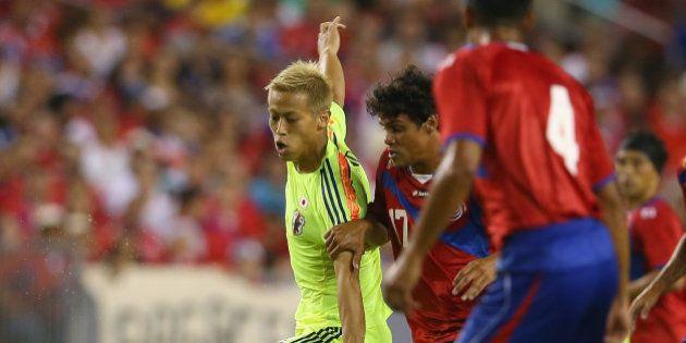 TAMPA, FL - JUNE 02: Keisuke Honda of Japan runs the ball during the International Friendly Match between...