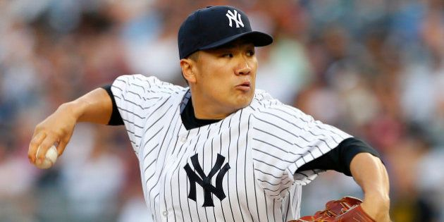 NEW YORK, NY - JUNE 28: Masahiro Tanaka #19 of the New York Yankees delivers a pitch against the Boston...