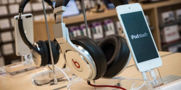 NEW YORK, NY - MAY 09: Beats headphones are sold along side iPods in an Apple store on May 9, 2014 in...