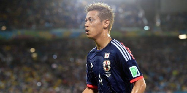 Japan's forward Keisuke Honda is pictured during a Group C match between Japan and Greece at the Dunas...