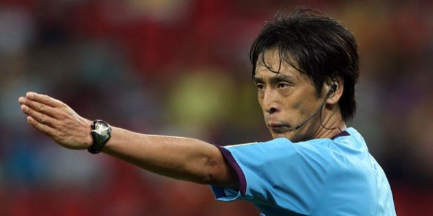 RECIFE, BRAZIL - JUNE 16: Referee Yuichi Nishimura gestures during the FIFA Confederations Cup Brazil...