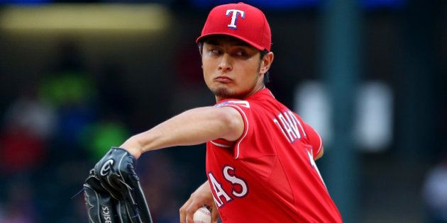 ARLINGTON, TX - MAY 09: Yu Darvish #11 of the Texas Rangers throws against the Boston Red Sox in the...
