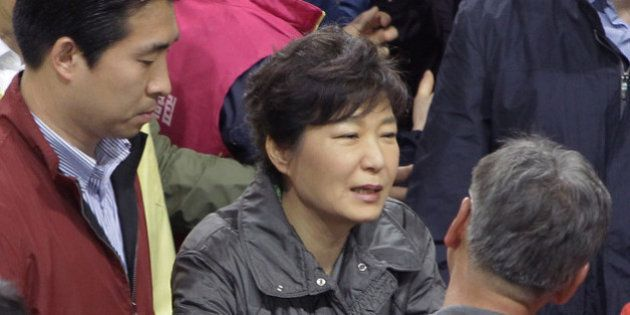 JINDO-GUN, SOUTH KOREA - APRIL 17: South Korean President Park Geun-Hye talks with relatives of missing...