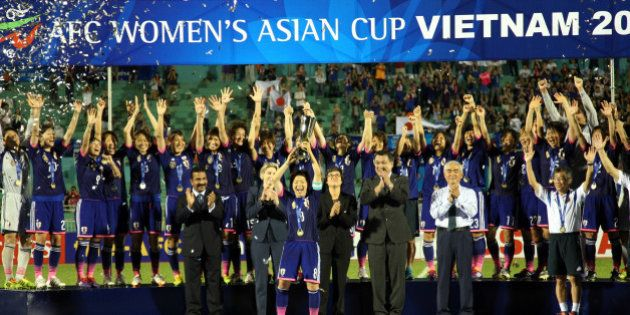 HO CHI MINH CITY, VIETNAM - MAY 25: Japan celebrates with the Asian Cup Trophy after they defeated Australia...