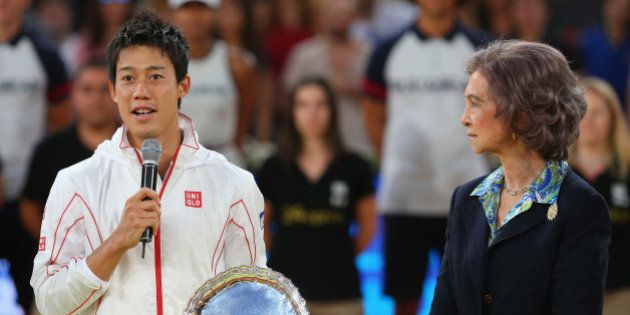 MADRID, SPAIN - MAY 11: Kei Nishikori of Japan makes his losers speach as Queen Sofia of Spain listens...