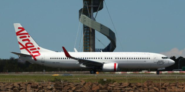 A Boeing Co. 737 aircraft operated by Virgin Australia Holdings Ltd. taxis on the runway at Sydney Airport...