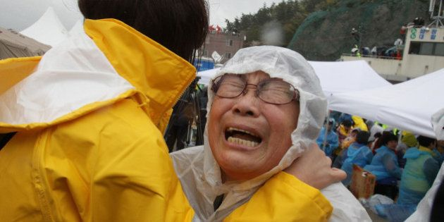 JINDO-GUN, SOUTH KOREA - APRIL 17: A relative weeps as she waits for missing passengers of a sunken ferry...