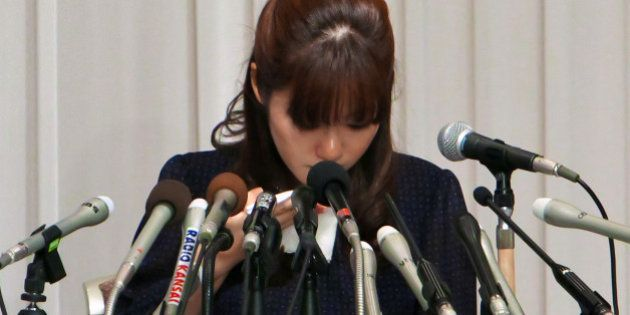 Haruko Obokata, a researcher at Riken research institution, cries during a news conference in Osaka,...