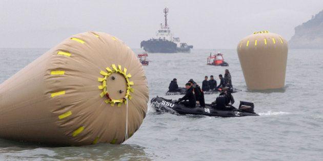 JINDO-GUN, SOUTH KOREA - APRIL 18: South Korean Navy rescue teams work near to the buoys installed to...