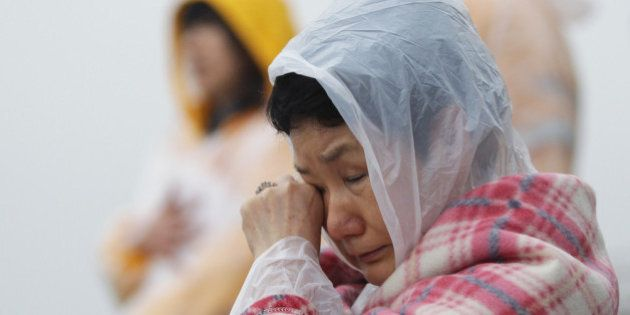 JINDO-GUN, SOUTH KOREA - APRIL 18: A relative weeps as she waits for missing passengers of a sunken ferry...