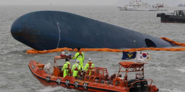 JINDO-GUN, SOUTH KOREA - APRIL 17: South Korean Coast Guard and rescue teams search for missing passengers...
