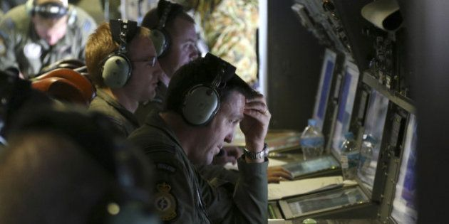 AT SEA - APRIL 04: Operators monitor TAC stations onboard a RNZAF P3 Orion during search operations for...