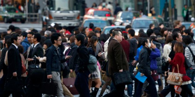 Pedestrians cross an intersection in the Shibuya district of Tokyo, Japan, on Friday, Nov. 22, 2013....