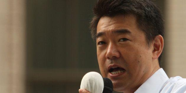OSAKA, JAPAN - JULY 04: Japan Restoration Party deputy leader Osaka Mayor Toru Hashimoto speaks to voters...