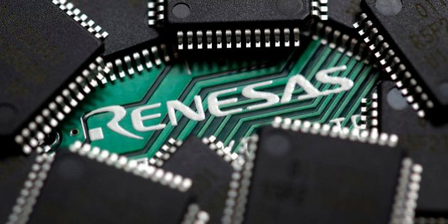 A Renesas Electronics Corp. central processing unit (CPU) board and microcontrollers are arranged for...