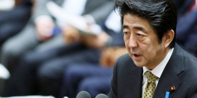 Shinzo Abe, Japan's prime minister, speaks during a budget committee session in the lower house of the...