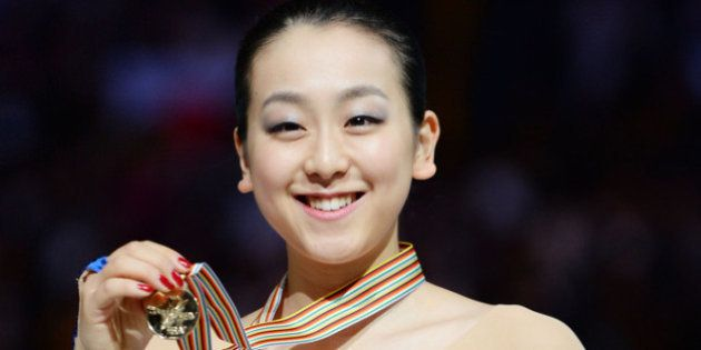 SAITAMA, JAPAN - MARCH 29: Mao Asada (Gold) of Japan poses with medal in the victory ceremony during...