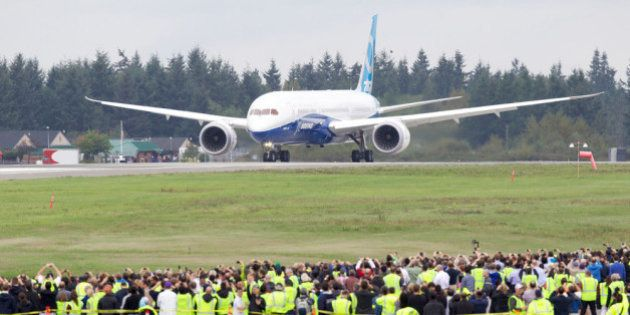 EVERETT, WA - SEPTEMBER 17: A Boeing 787-9 Dreamliner taxis on the runway in front of a crowd of employees...