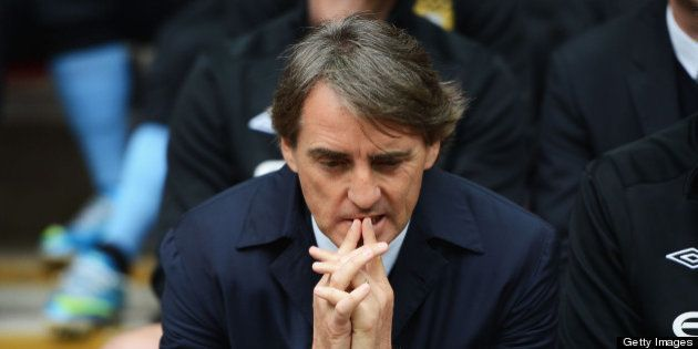LONDON, ENGLAND - MAY 11: Roberto Mancini, manager of Manchester City looks dejected during the FA Cup...