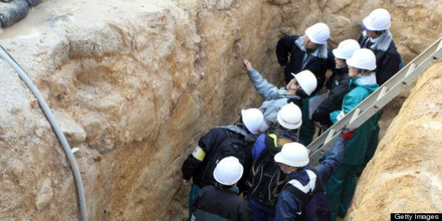 This picture, taken on December 1, 2012 shows geologists checking fault lines near Japan Atomic Power...