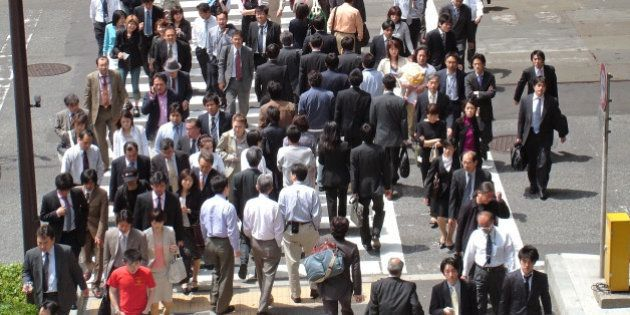 Japanese workers walking to work in downtown Tokyo Japan Asia (Photo by: myLoupe/Universal Images Group...