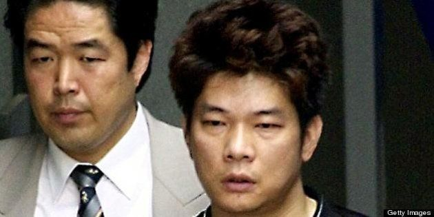 IKEDA, JAPAN: Mamoru Takuma (R), who allegedly stabbed eight children to death in an elementary to school...