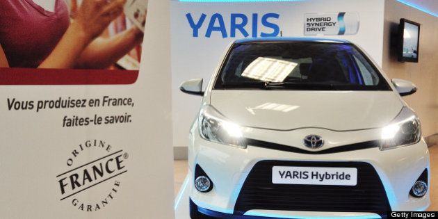 A Yaris is exhibited at the entrance at the plant of Japan's Toyota carmaker on October 8, 2012 in Onnaing,...