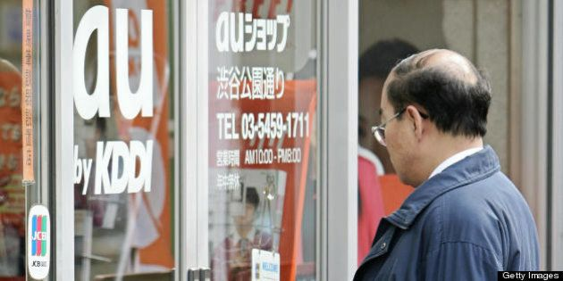 TOKYO, JAPAN: A man enter a mobile phone shop of 'au', mobile service brand of Japan's number two telecoms...