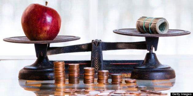 dollars and apple on the antique scales, Piles of coins at front of