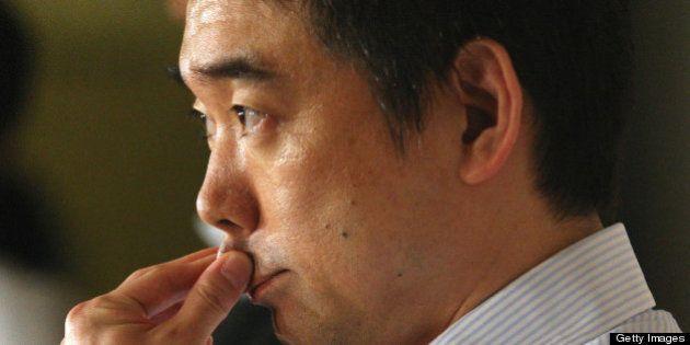 Osaka Mayor and Japan Restoration Party co-leader Toru Hashimoto speaks to repoprters at Osaka city hall...