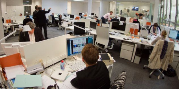 Journalists work inside the newsroom of new French media company 'L'Opinion', which aims to be a daily...