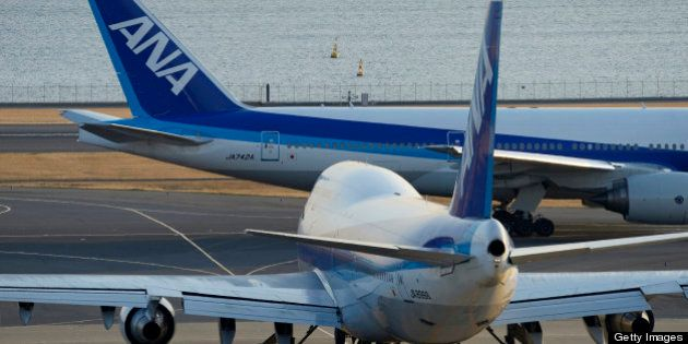 A Boeing Co. 747-400 aircraft, front, and a Boeing Co. 777-200 aircraft, both operated by All Nippon...