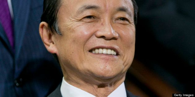 Taro Aso, Japan's deputy prime minister and finance minister, attends an International Monetary Fund...