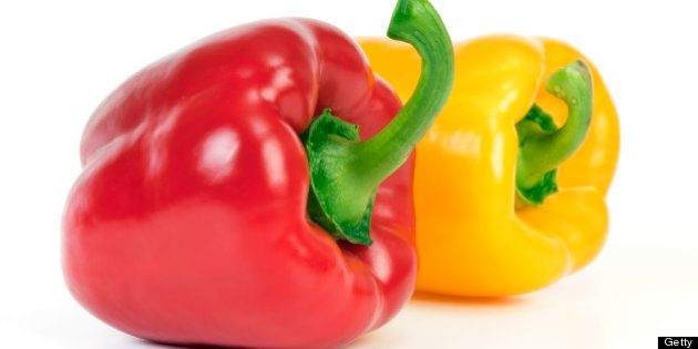 Yellow and red bell pepper isolated on white