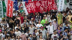 香港で普通選挙求め10万人デモ