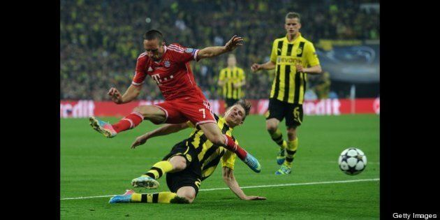LONDON, ENGLAND - MAY 25: Lukasz Piszczek of Borussia Dortmund tackles Franck Ribery of FC Bayern Muenchen...