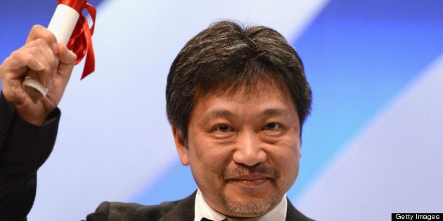 CANNES, FRANCE - MAY 26: Director Hirokazu Koreeda on stage after 'Soshite Chichi Ni Naru' receives the...