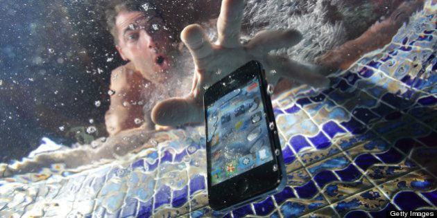 Smart phone being dropped into swimming