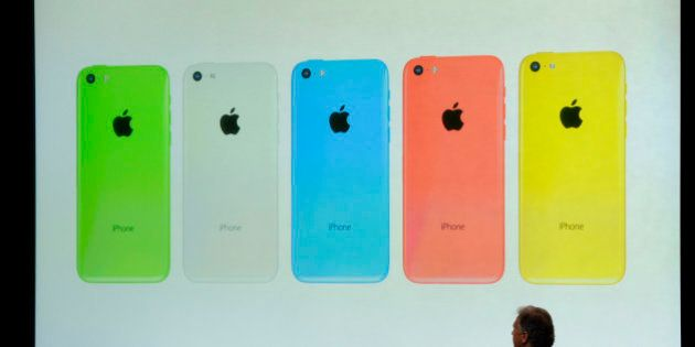 Philip Schiller, senior vice president of worldwide marketing at Apple Inc., introduces a new iPhone...