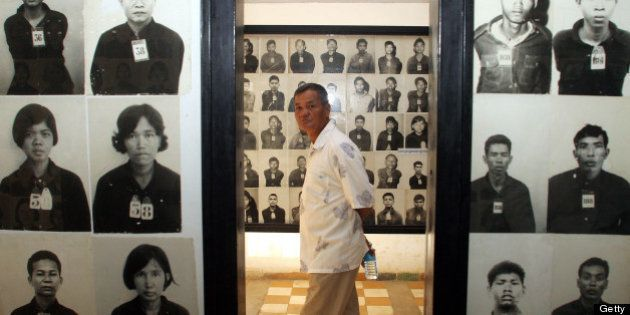 A man visits Tuol Sleng genocide museum in Phnom Penh, 26 June 2006. Twenty-seven years after the fall...