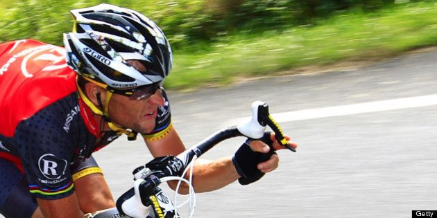 US Lance Armstrong speeds in a descent during the 199,5 km and 16th stage of the 2010 Tour de France...
